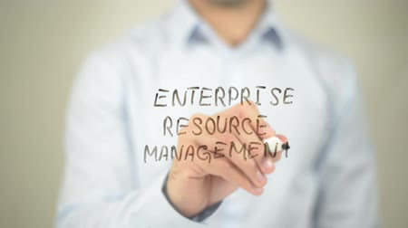 recursos : Enterprise Resource Management   ,  man writing on transparent wall Vídeos