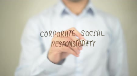 corporate : Corporate Social Responsibility   ,  man writing on transparent wall Stock Footage