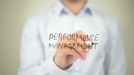 сценарий : Performance Management  , writing on transparent wall Стоковые видеозаписи