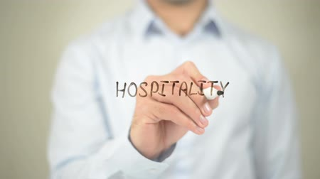 self motivated : Hospitality  , writing on transparent wall