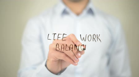 igual : Life Work Balance , writing on transparent wall Stock Footage