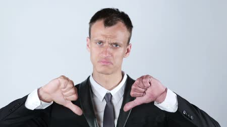 límec : Businessman making thumbs down gesture with both hands Dostupné videozáznamy