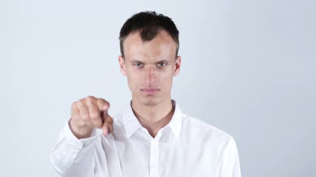 поиск : man wearing white shirt   points at camera , white background
