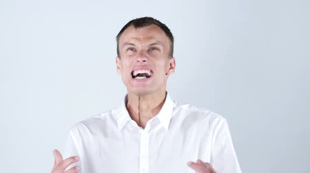 ludzik : Close-up of angry businessman screaming against blue background