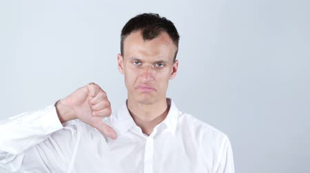 mračící : Businessman frowning and giving  thumbs down. Dostupné videozáznamy