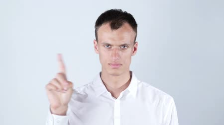 interdiction : No Closeup portrait young angry serious man showing his denial Stock Footage