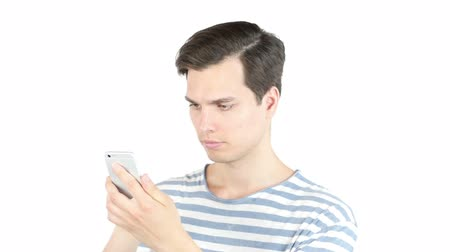 sending : Young man browsing internet on smart phone Stock Footage
