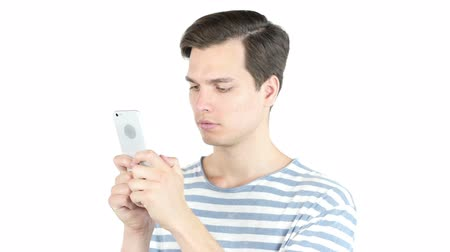 sending : Young man typing email ,sms ,massage  on smart phone , isolated white background Stock Footage