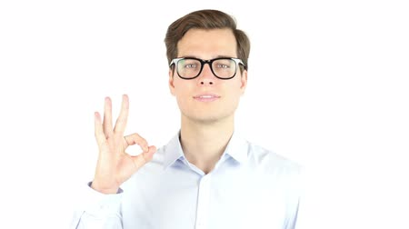 okey : Young man shows sign and symbol ok on white background