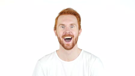 Man with wow face , red hair , success ,