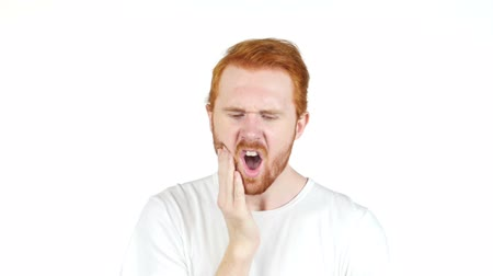 зубы : Frustrated redhair young  man with a toothache , tooth pain Стоковые видеозаписи