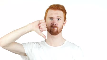 adam : portrait red hair man showing thumbs down sign, in disapproval of offer,