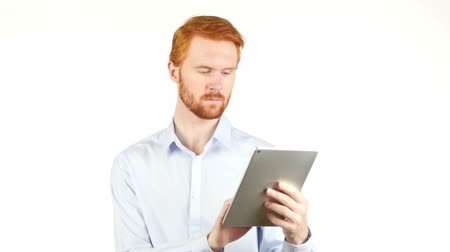 executivo : Portrait of a business man using a tablet Stock Footage