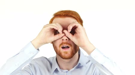 recursos : Portrait of a businessman using binoculars, searching for opportunities ,