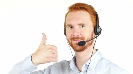 fejhallgató : Handsome happy phone operator showing ok sign Stock mozgókép