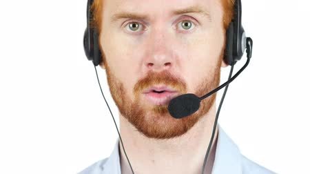 fejhallgató : Customer service person talking on headset Stock mozgókép