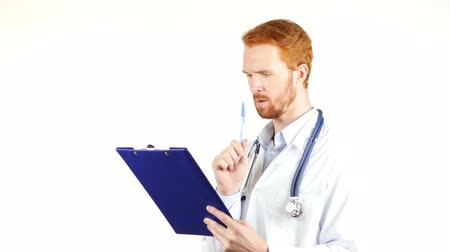 przychodnia : Doctor, surgeon reading medical reports , white background Wideo