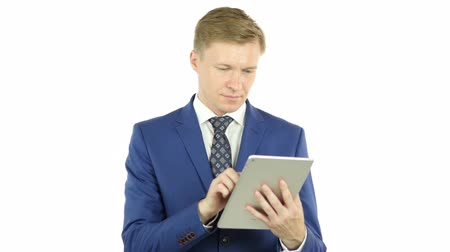 latino americana : Businessman using a tablet computer - isolated over a white background