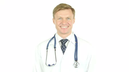 sebész : Confident doctor posing and smiling at camera