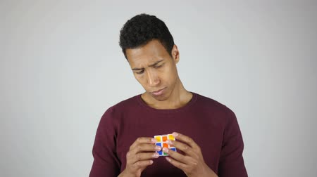 difficults : Solving Rubik cube, Intelligent Young Man Stock Footage