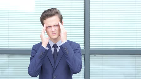 feszült : Headache, Upset Gesture by Young Businessman