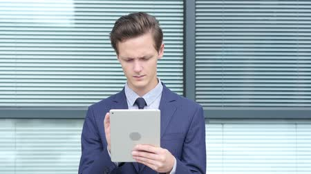 movements : Young Businessman Using Tablet, Outdoor Stock Footage