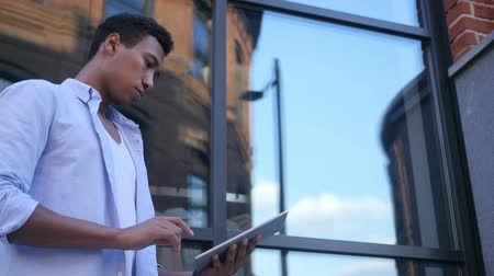 projektant : Busy Working Online on Tablet, Standing Young Black Male Designer