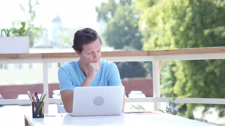 chest pain : Coughing Young Man at Work, Sitting Outdoor Stock Footage