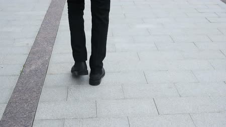 walking back : Walking Feet Back View Stock Footage