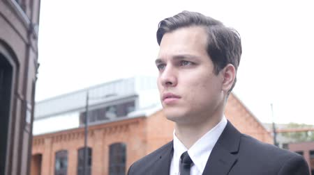 manges : Walking Serious Young Businessman to Office Stock Footage