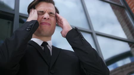 feszült : Frustrated, Tense Young Businessman with Headache and Problems Stock mozgókép