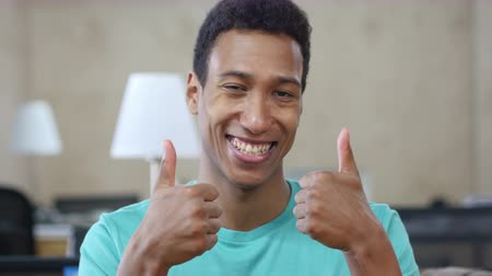 suceder : Thumbs Up by Young Black Man with Both Hands, Portrait
