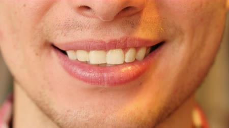 kapatmak : Close Up of Man Smiling Lips and Teeth Stok Video