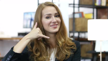 выбирать : Girl Pointing toward Camera At Work