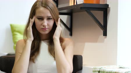 adorável : Tired Beautiful Girl, Sitting w  Headache, Frustrated Stock Footage