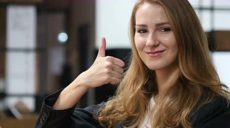 kapatmak : Thumbs Up by Beautiful Girl Sitting Indoor, Portrait