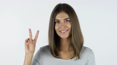 único : Victory Sign by Girl, White Background in Studio Stock Footage