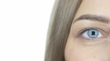 eye : Close Up Of Blinking Eye Looking At Camera, White Background Stock Footage