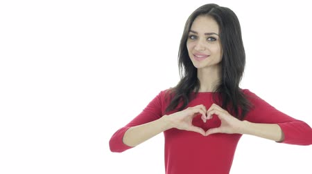 felnőtt : Handmade Heart Sign by Young Woman, White Background Stock mozgókép