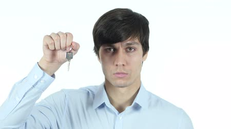 pracodawca : Businessman Showing Keys of House, White Background