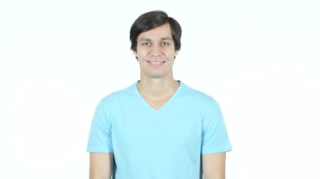 kapatmak : Portrait Of Smiling Young Casual Man, White Background Stok Video