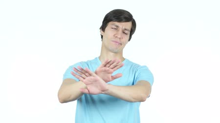 peeved : Denying, Refusing, Disliking Gesture by Young Casual Man, White Background
