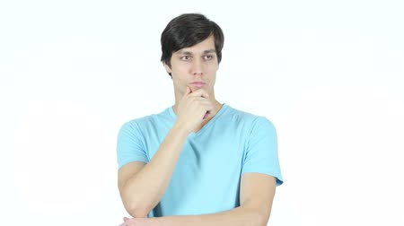 único : Thinking Serious Young Man, White Background Stock Footage