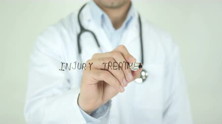 травма : Injury Treatment, Doctor Writing on Transparent Screen Стоковые видеозаписи