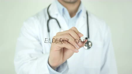 ginásio : Elderly Care, Doctor Writing on Transparent Screen Stock Footage