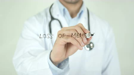 yöneticiler : Loss Of Memory, Doctor Writing on Transparent Screen