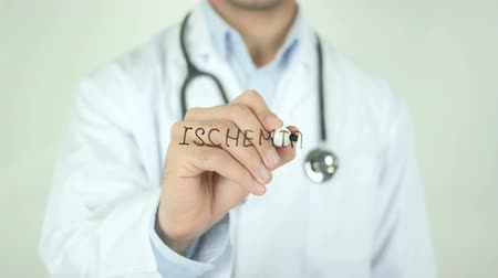 lekarstwo : Ischemia, Doctor Writing on Transparent Screen