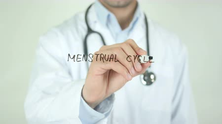 alfa : Menstrual Cycle, Doctor Writing on Transparent Screen