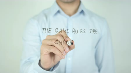 estratégico : The Game Rules Are Changing, Man Writing on Screen Stock Footage