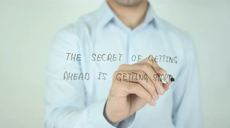 anlamı : The Secret of Getting Ahead is Getting Started, Writing On Transparent Screen Stok Video